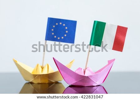 paper ship with italian and european flag, concept shipment or free trade agreement and membership of eu