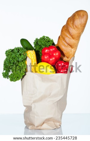 Paper shopping bag full of food - stock photo