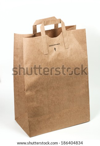 Paper shopping bag isolated on white background - stock photo