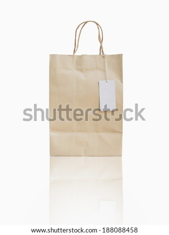 paper shopping bag with paper handles and white tag,isolated - stock photo