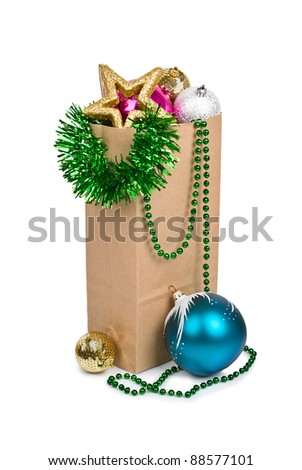 Paper shopping bags christmas composition with balls and stars isolated on white background - stock photo