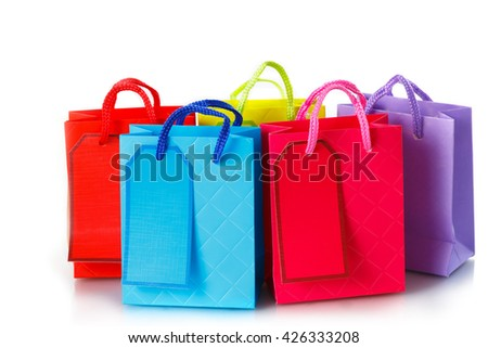 Paper shopping bags on white background - stock photo