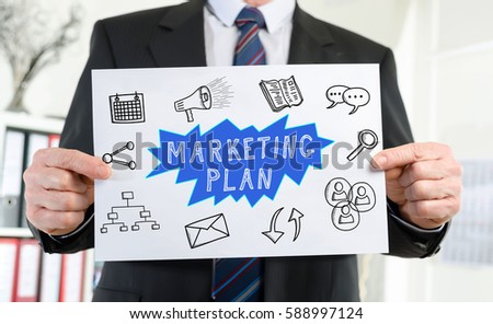 Paper showing marketing plan concept held by a businessman