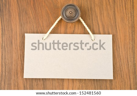Paper signboard with rope hanging on a handle of door   - stock photo