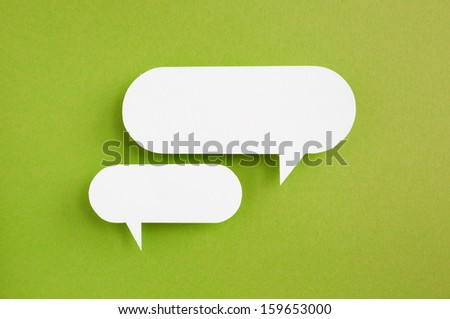 paper speech bubble on green background