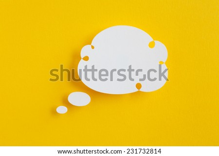 paper speech bubble on yellow background - stock photo