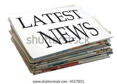 "Paper stack. Top file showing ""latest news""."