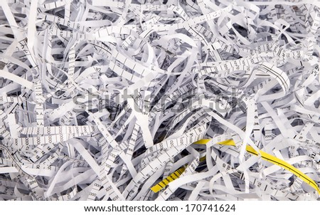 Paper strips from a shredder - stock photo