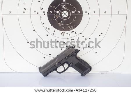 paper target and gun magazine. - stock photo
