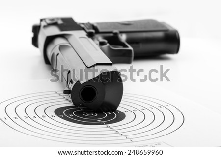 Paper target and pistol on white - stock photo