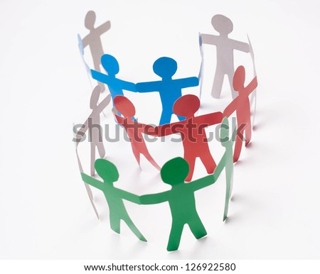 Paper team on the white background. - stock photo
