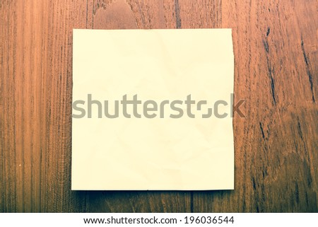 Paper template on grunge wood - stock photo