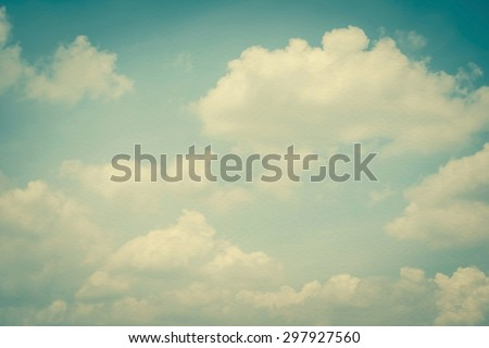 Paper texture background of retro style blurred sky with soft clouds: Water colour  textured paper with cyan blue cloudy sky in vintage color tone     - stock photo