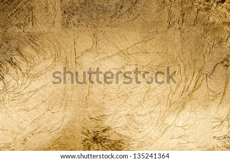 Paper texture in shades of beige and gold - stock photo