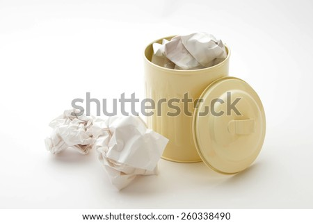 Paper trash and trash can on white background - stock photo