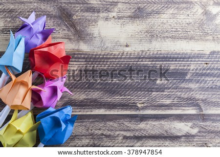 paper tulips on wooden table spring concept - stock photo