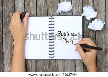 Paper waiting for idea with hand and pen - stock photo