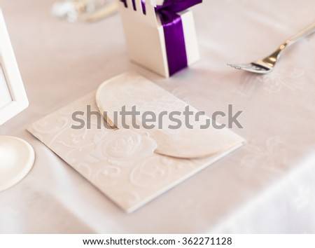 Paper wedding invitation on the table - stock photo
