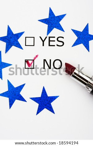 Paper with boxes with the words yes and no with lipstick and blue stars, voting