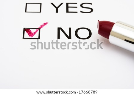 Paper with boxes with the words yes and no with lipstick, voting
