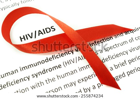 Paper with Hiv aids and red ribbon - stock photo