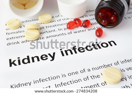 Paper with kidney infection and pills. Medical concept. - stock photo