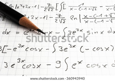 paper with maths-formulas and a pencil - education concept - stock photo