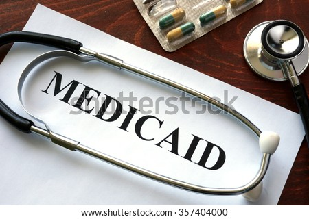 Paper with Medicaid and stethoscope. Medical insurance concept. - stock photo