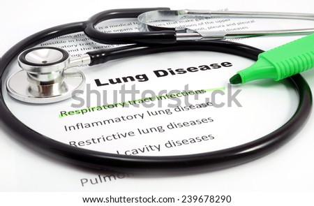 Paper with words  Lung Disease and Respiratory tract infections with marker and stethoscope - stock photo