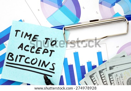 Paper with words time to accept bitcoins  and graphs.  - stock photo