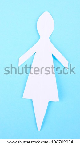 Paper woman on blue background - stock photo