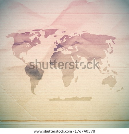 Paper World Map on Dirty Cardboard Paper - stock photo