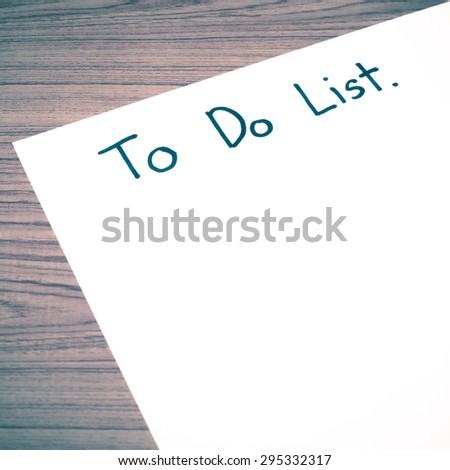 paper write to do list word on wood background vintage style