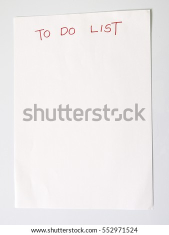 Paper written to do list on white background.