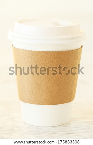 Papercup with a cardboard holder - stock photo