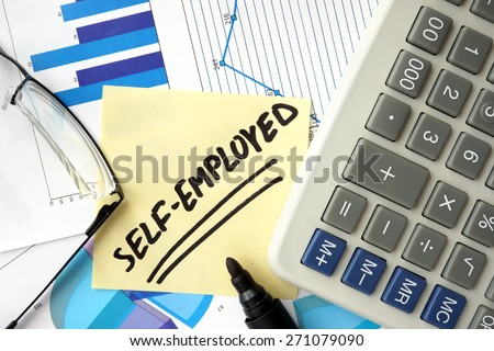 Papers with graphs and word  self-employed. - stock photo