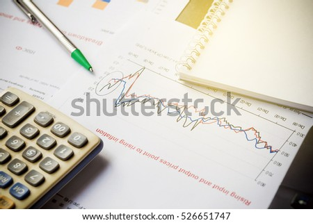 Papers with graphs data calculator and pen on wood table, Business growth concept.