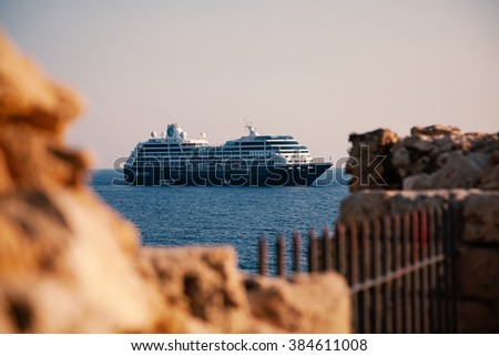 Paphos, Cyprus - July 16, 2015: View of cruise ship Azamara Journey from old medieval Fort - stock photo