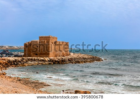 PAPHOS, CYPRUS - MARCH 13, 2016: Popular tourist attraction Paphos castle was originally a Byzantine fort built to protect the harbour.  - stock photo