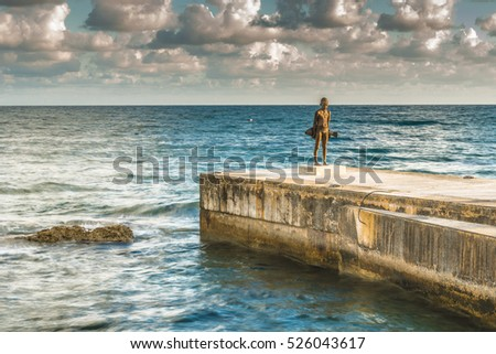Paphos, Cyprus, September  22, 2016 ; Statue of a boy with a fish on the shore of the Mediterranean Sea.