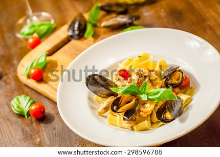 Pappardelle with fresh mussels and salmon - stock photo