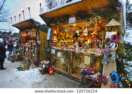 PAPPENHEIM, GERMANY - DECEMBER 2: Romantic Christmas market with illuminated shops for gift and decoration on December 2, 2012 in Pappenheim, Bavaria, Germany - stock photo