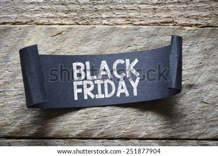 Papper with black friday. Black papper with black friday on wooden background - stock photo