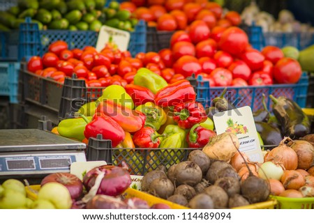 Paprika, beet roots, tomatoes, onion on city market - stock photo