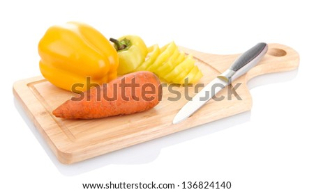 paprika, carrot and knife on wooden cutting board isolated on white