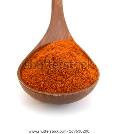 Paprika ground in wooden spoon on white background. Used to color rices, stews, and soups, meats.  - stock photo