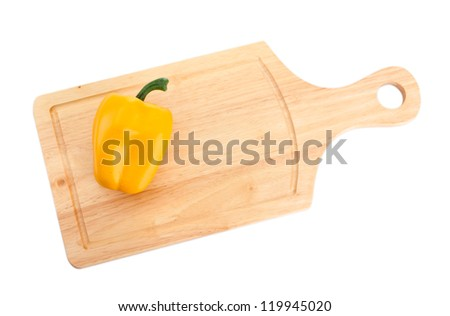 paprika on wooden cutting board isolated on white
