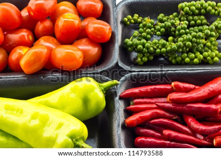 Paprika, pepper, corn, tomato, pepper seeds on a white backgroun