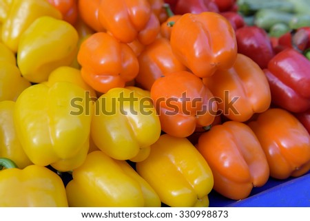 Paprika peppers of diferent colours sold at a street market