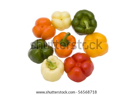 Paprika pieces in five different colors isolated on white background